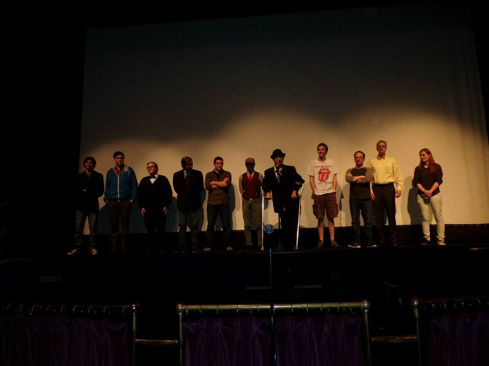 Jesse (center) with the cast and crew of Mello